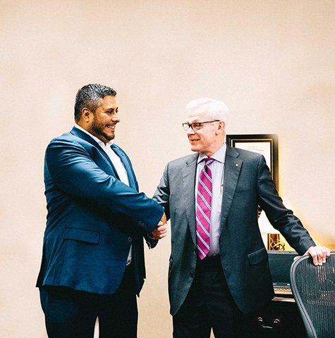 Image of TextbookHub Founder, Javier Jurado, shaking hands with BJU Press President, William E. Apelian.